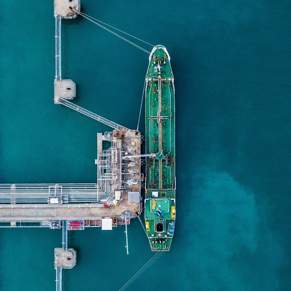 Aerial top view oil tanker ship under cargo operations